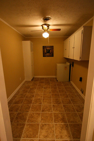 Large mud room. Spacious cabinets, washer and dryer location. Brand new tile, easy to maintain tile floors.