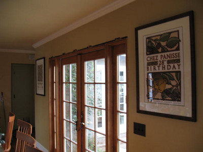 Chez Panisse posters framing the french doors. The doors will have post and lentil trim once we sort out some problems with the doors.