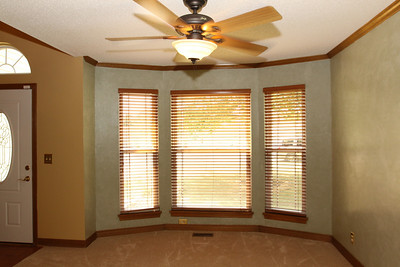 Formal Dining Room - Premium ceiling fans are used to accent the decor and enhance air movement in five (5) rooms of the house.