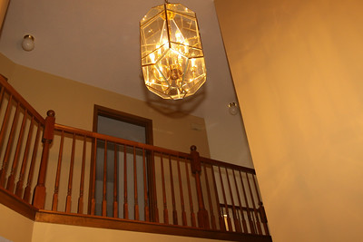 Entrance Foyer & Stairway features a large and elegant chandelier.