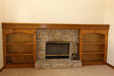 Great Room - hearth and bookcases on the south wall.