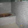 Our master bathroom. The fish scale tiles in a light lavender-blue give the room a zen-like feeling.