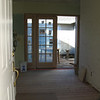 The same foyer view with the French door open.