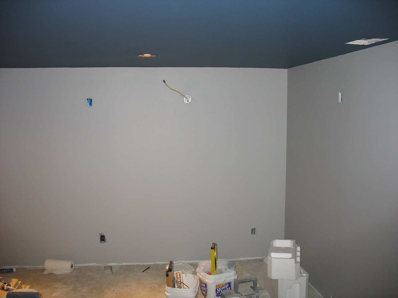 The ceiling is done, but the walls still need the color washing. The room also needs baseboards and crown molding.