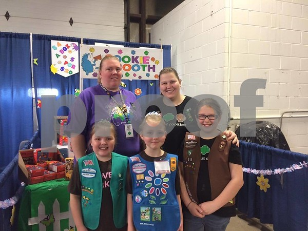 Adriana McCusker, Caitlyn McCusker, Morgan Saxton, Tara Saxton, and Amanda Kocour selling Girl Scout's cookies at the Home and Garden Expo.