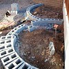02/22/16: The radial curves of the left raised Bench and Planter Beds begin to take shape.