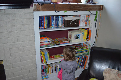 Maddie's bookcase!  Look at all those books!