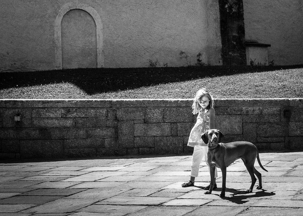 Hungarian Vizsla and young girl outside the church in Chamonix, France, Summer 2013.