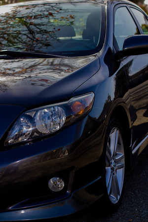 The waiting list for a Tesla was too long. So this is our new used car. A 2009 Toyota Corolla. It's actually dark gray. I don't know who edited this photo...?