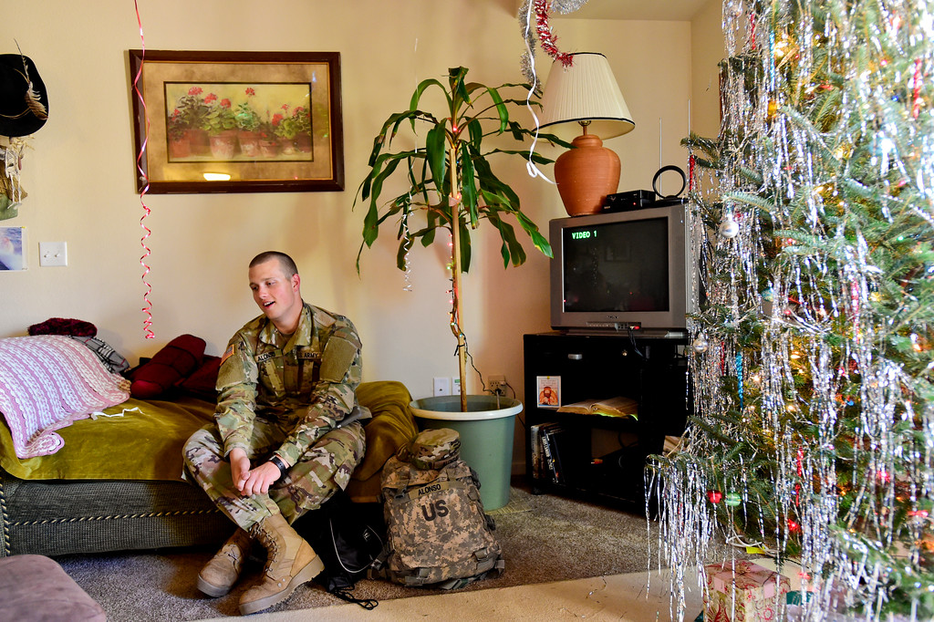 . Adam Alonso rests on a couch at his mother\'s apartment in Longmont, Colorado on Dec. 19, 2017. (Photo by Matthew Jonas/Staff Photographer)