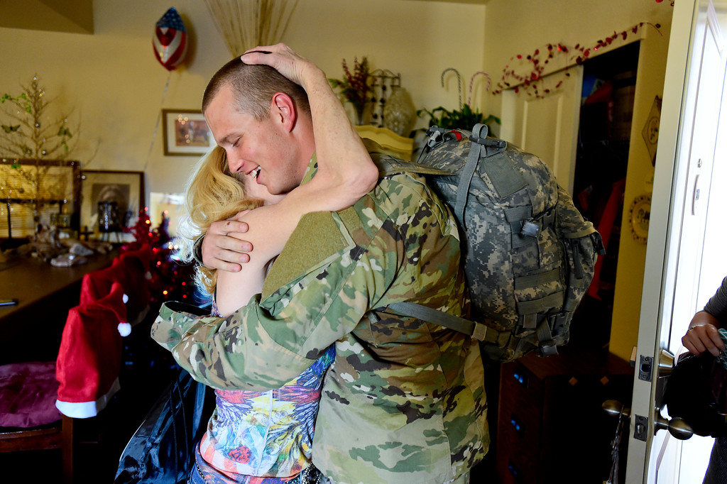 . Adam Alonso hugs his mother Teresa Alonso in Longmont, Colorado on Dec. 19, 2017. Adam is on leave from basic training during the holidays. He will return to finish in January.  (Photo by Matthew Jonas/Staff Photographer)