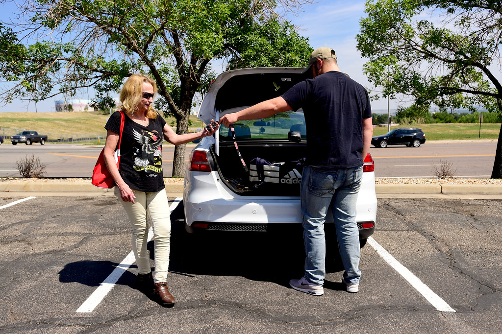 . Adam Alonso gives the keys to his car to his mother Teresa Alonso outside the armed forces recruiting office in Thornton, Colorado before leaving for basic training on Aug. 20, 2017.  (Photo by Matthew Jonas/Times-Call)