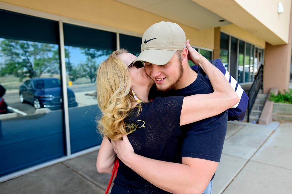 . Adam Alonso hugs his mother Teresa Alonso outside the armed forces recruiting office in Thornton, Colorado before leaving for basic training on Aug. 20, 2017.  (Photo by Matthew Jonas/Times-Call)
