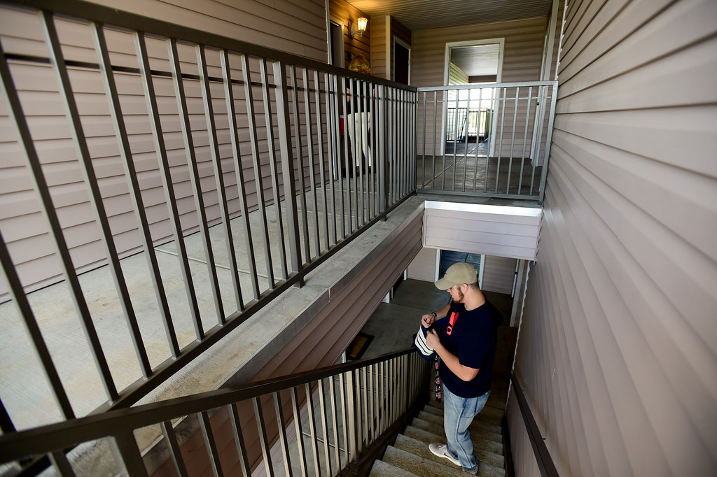 . Adam Alonso waits in the stairwell for his mother Teresa Alonso after leaving his apartment in Longmont, Colorado on Aug. 20, 2017. Alonso was headed to the armed forces recruiting office in Thornton, Colorado before heading to basic training. (Photo by Matthew Jonas/Times-Call)