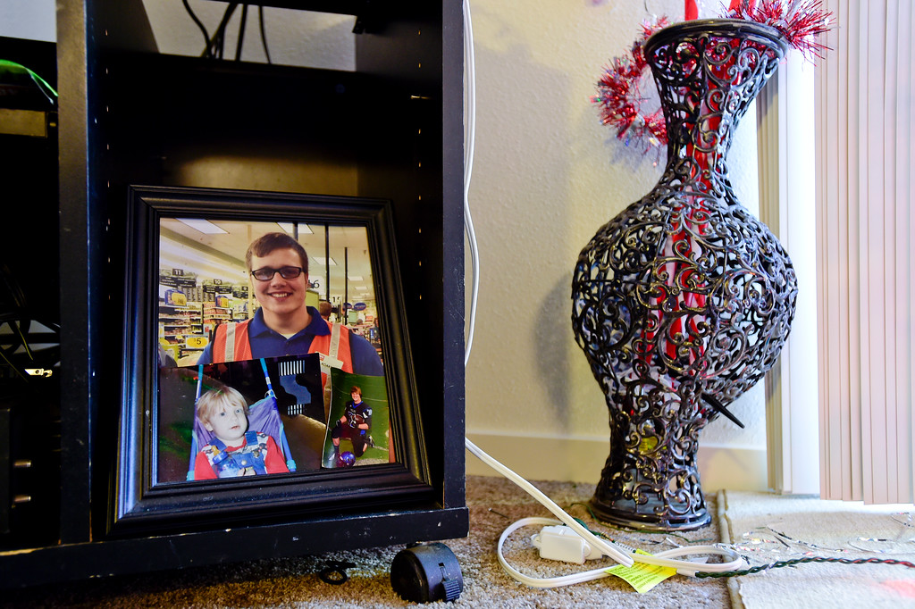 . Photos of Adam Alonso are seen in a picture frame on his mother\'s TV stand at her apartment in Longmont, Colorado on Dec. 19, 2017. (Photo by Matthew Jonas/Staff Photographer)