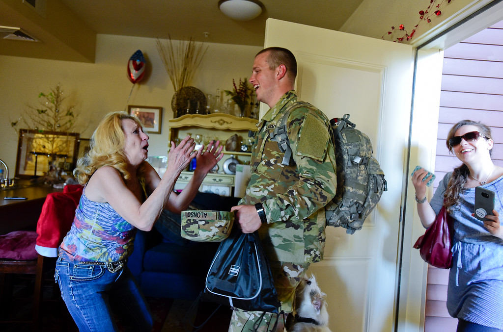 . Teresa Alonso reacts to seeing her son Adam Alonso in Longmont, Colorado on Dec. 19, 2017. Adam is on leave from basic training during the holidays. He will return to finish in January.  (Photo by Matthew Jonas/Staff Photographer)
