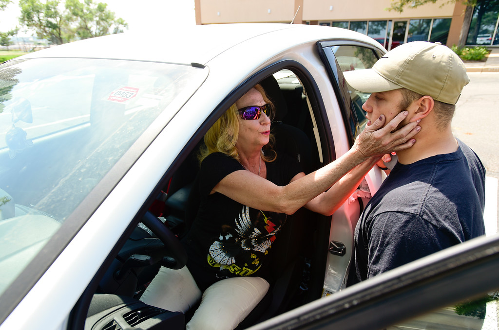 . Adam Alonso talks with his mother Teresa Alonso outside the armed forces recruiting office in Thornton, Colorado before leaving for basic training on Aug. 20, 2017. Adam was telling his mother how to adjust the seat of his car after turning it over to her before he left for basic training.  (Photo by Matthew Jonas/Times-Call)