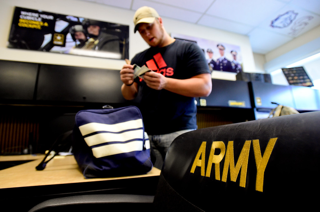 . Adam Alonso checks to make sure he has his drivers license, social security card and a debit card inside the armed forces recruiting office in Thornton, Colorado before leaving for basic training on Aug. 20, 2017.  (Photo by Matthew Jonas/Times-Call)