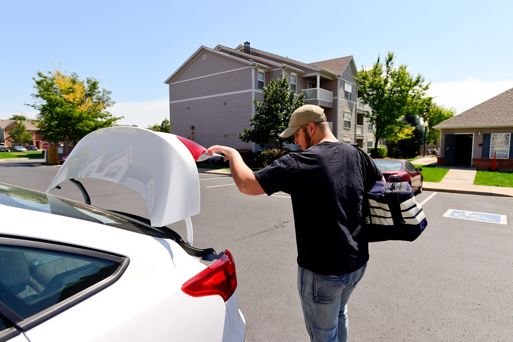 . Adam Alonso loads a bag into his car with a few personal items he will be allowed to take with him to basic training before leaving his apartment in Longmont, Colorado before on Aug. 20, 2017.  (Photo by Matthew Jonas/Times-Call)