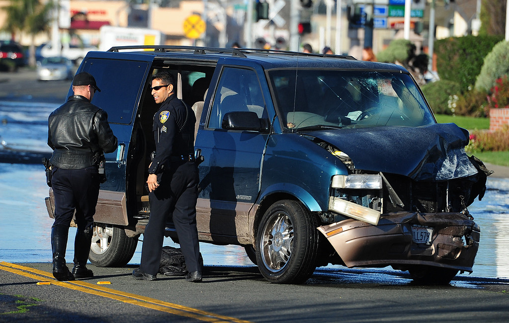 . (CHRIS RILEY �TIMES-HERALD) Vallejo police discovered multiple weapons inside this Astro van after suspects in a home invasion homicide from in Santa Rosa crashed into another vehicle on Thursday in Vallejo.