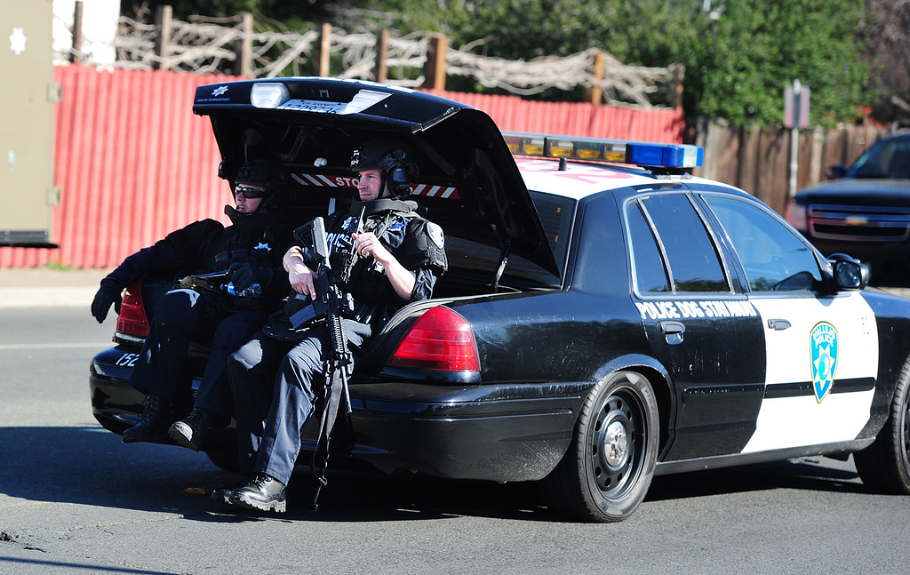. (CHRIS RILEY �TIMES-HERALD) Vallejo Police officers ride in the trunk of a vehicle as they  search for two homcide suspects on Thursday.
