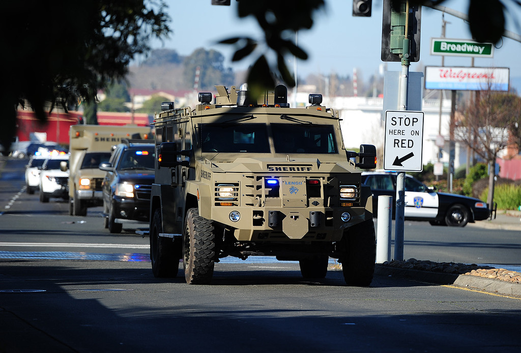 . (CHRIS RILEY �Times-Herald) An armored vehicle brings in the Solano Sheriff SWAT team as they search for two homicide suspects on Redwood Street.