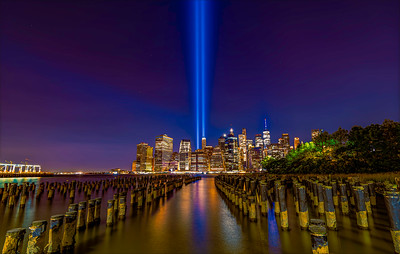 Captured from Brooklyn Bridge Park, Brooklyn NY 9/11/2021. Photos taken through caring degrees of darkness and air , sea traffic.