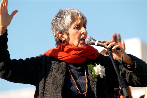 Joan Baez shouts out against the war at a San Francisco rally in 2003.
