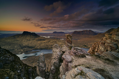 Assynt sandstone stacks at sunset with views over the Assynt mountain Range, Northwest Highlands, Scotland.