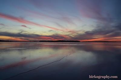 An amazing January sunset on frozen Lake Minnetonka! With Big Island dead center.  Main lake, Lake Minnetonka, MN