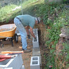 Friday, April 23, John is hard at work on the retaining wall.