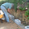 John working on the retaining wall for the tank farm.