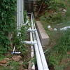 The pipes to take the water into the house and from the roof to the tanks.