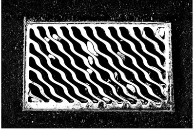 """I love the huge grates in Pittsburgh.  It always reminds me of Stephen King's """"It"""""""