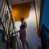 Cara painting the stairwell Tucson, AZ