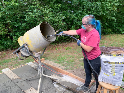 Mara mixes more concrete for the pizza-oven footer.