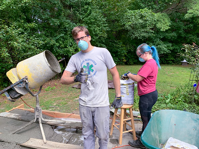 Andy and Mara mix more concrete for the pizza-oven footer.