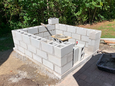 The cinderblock base for the pizza oven.