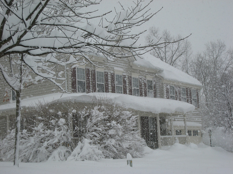 Check out the snow on the neighbor's porch roof!