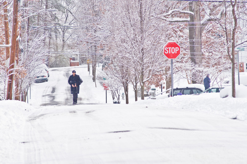 Title: Snow Covered Streets<br /> Date: March 2009<br /> A person walks in the middle of Kilmer Street after a snow storm.