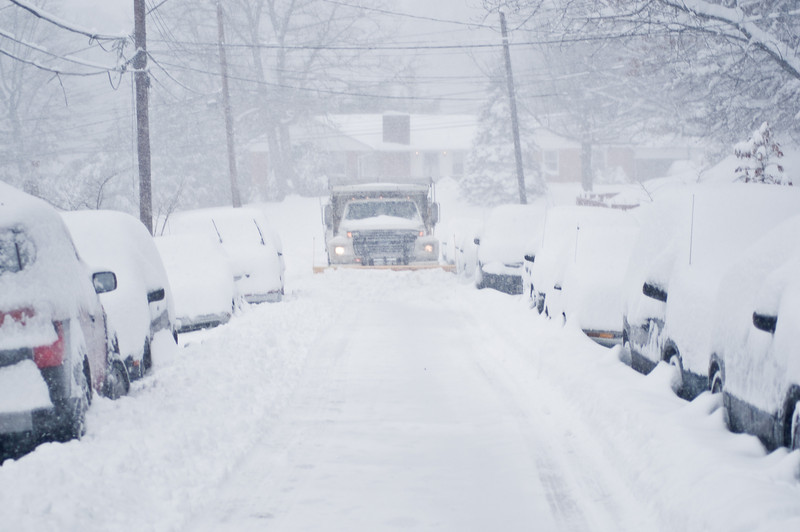 Title: Eye-to-Eye with the Beast<br /> Date: December 2009<br /> A snow plow clears Inwood Street during a massive December snow storm.