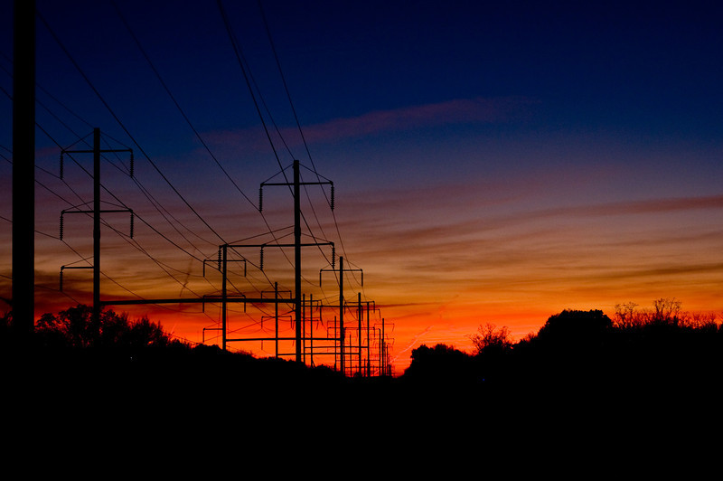Title: Sunset into the District<br /> Date: November 2009<br /> Sunset along the power lines that follow the train tracks into the District.  Taken from Columbia Park Road just above the Cheverly Metro station.
