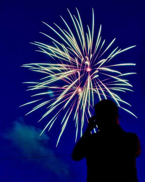 Title: Picture Perfect<br /> Date: June 2009<br /> A spectator takes a picture of the annual Cheverly Day fireworks.