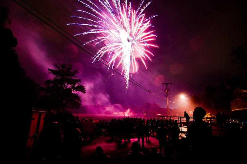 Title: A Moment for Cheverly<br /> Date: May 2010<br /> A spectator looks on during the annual Cheverly Day fireworks.
