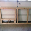 The front panel, with a framed opening where the nesting boxes will go and also an opening for the chicken/front door.