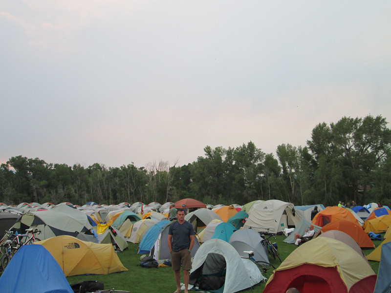 Its hard to see but in the back there are perfect rows of the same tent, that's a service where a group of people set up and take down your tent for you.  I didn't sign up for that, seems like laziness costs about $350.
