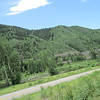 A sideways, taken while riding, picture of the road we traveled after Aspen, still Day 2