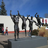 Olympic Training Center: the right most figure is help up with very little iron