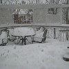 Still snowing... by the end of the night, the bottom of the chairs are buried as well