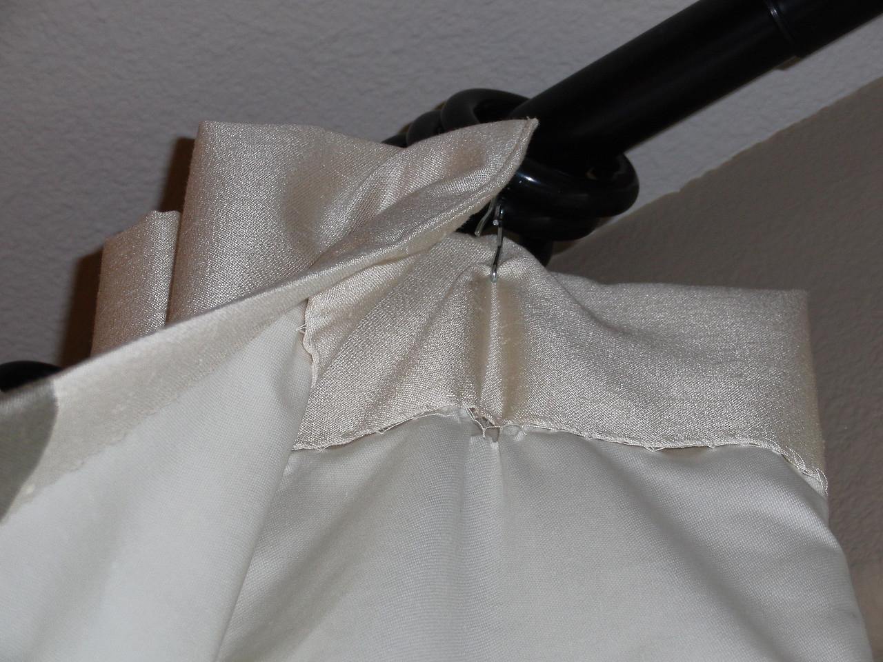 Master bedroom curtain rod/ring/hook details.